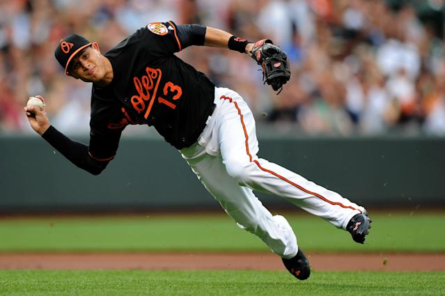 BALTIMORE, MD - JUNE 28: Third basemen Manny Machado #13 of the Baltimore Orioles cannot make an out on Zoilo Almonte #45 of the New York Yankees (not pictured) in the second inning at Oriole Park at Camden Yards on June 28, 2013 in Baltimore, Maryland. (Photo by Patrick Smith/Getty Images)