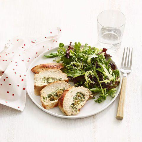 """<p>Stuffing chicken breasts is a great way to kick things up a notch. This chicken looks oh so fancy, but it only takes half an hour to from start to finish. </p><p><em><a href=""""https://www.womansday.com/food-recipes/food-drinks/recipes/a12518/dill-raisin-cheese-stuffed-chicken-breasts-recipe-wdy0814/"""" rel=""""nofollow noopener"""" target=""""_blank"""" data-ylk=""""slk:Get the Dill, Raisin, and Cheese-Stuffed Chicken Breasts recipe."""" class=""""link rapid-noclick-resp"""">Get the Dill, Raisin, and Cheese-Stuffed Chicken Breasts recipe. </a></em></p>"""