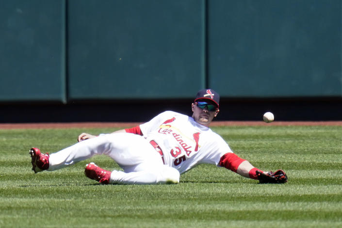 St. Louis Cardinals center fielder Lane Thomas is unable to catch a double by Milwaukee Brewers' Manny Pina during the first inning of a baseball game Sunday, April 11, 2021, in St. Louis. (AP Photo/Jeff Roberson)