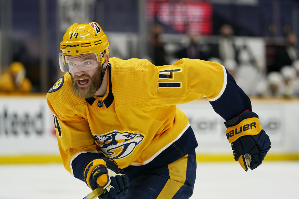 FILE - Nashville Predators defenseman Mattias Ekholm (14) plays against the Chicago Blackhawks in the third period of an NHL hockey game in Nashville, Tenn., in this Wednesday, Jan. 27, 2021, file photo. The NHL trade deadline is less than a week away and players such as Taylor Hall, Kyle Palmieri, Mikael Granlund and Mattias Ekholm are potentially available for teams willing to make a deal. (AP Photo/Mark Humphrey, File)