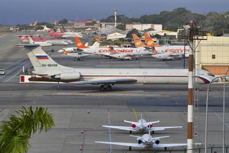 A Russian Ilyushin Il-62M Air Force plane, one of the two Russian military planes that arrived with troops and equipment to Venezuela in March, sits  on the tamrac at Simon Bolivar International Airport on March 28, 2019 in Maiquetia Venezuela