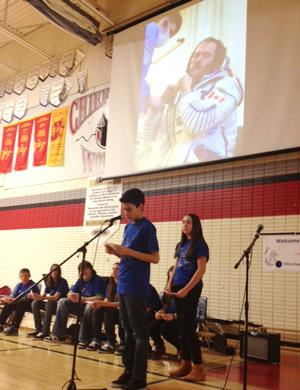 Astronaut Chris Hadfield speaks to students at Chief Peguis High in Winnipeg over radio contact from space on Wednesday.