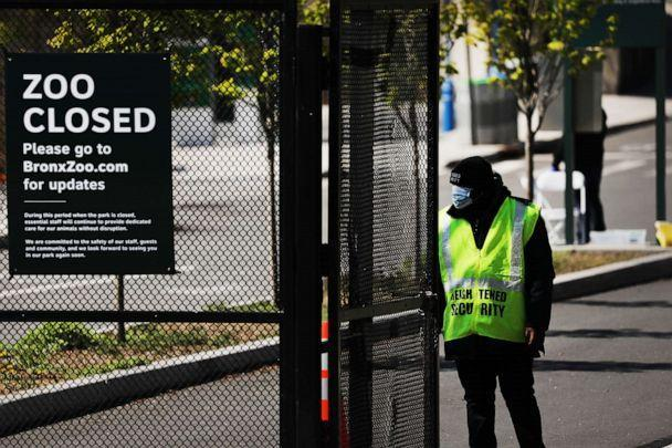 PHOTO: A guard stands at the entrance to the Bronx Zoo on April 06, 2020, in New York City. A four-year-old tiger named Nadia at the zoo tested positive for COVID-19, the Wildlife Conservation Society said in a statement on April 5. (Spencer Platt/Getty Images)