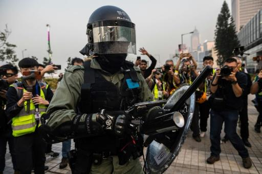 A police officer drew his side-arm and pointed it at the crowd but did not fire -- as an initially peaceful rally in Hong Kong descended into chaos