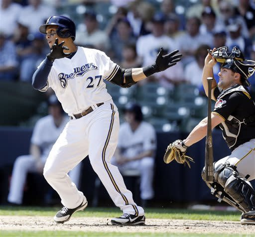 Milwaukee Brewers' Carlos Gomez (27) watches his home run with Pittsburgh Pirates' catcher Michael McKenry, right, during the fourth inning of a baseball game Wednesday, May 1, 2013, in Milwaukee. (AP Photo/Jeffrey Phelps)
