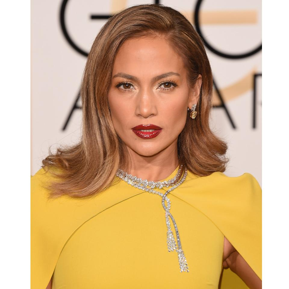 "<p>There's something warm and earthy about the lipstick makeup artist <a rel=""nofollow"" href=""https://www.instagram.com/p/BAaMt9kB0p8?hl=en&mbid=synd_yahoolife"">Mary Phillips</a> chose for Jennifer Lopez at the 2016 Golden Globes, making them a partner, not a competitor, with the star's copper silver eyes. By using very little eyeliner, the overall effect is less loud, although of course she still did use plenty of L'Oréal Paris Voluminous Original Mascara.</p> <p>There's a very good reason the lip color is so nuanced. It's actually a blend of three shades: The $10 <a rel=""nofollow"" href=""http://www.ulta.com/infallible-pro-matte-gloss?mbid=synd_yahoolife&productId=xlsImpprod13501021"">L'Oréal Paris Infallible Pro-Matte Gloss</a> in Rouge Envy, Nude Allude, and Forbidden Kiss.</p>"