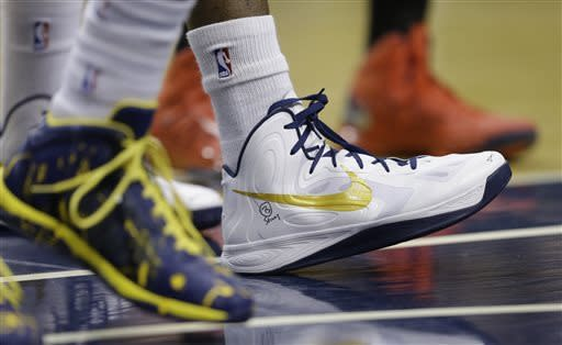 """Indiana Pacers' Roy Hibbert displays a """"B Strong"""" logo on his shoe during the first half of Game 1 in the first round of the NBA basketball playoffs against the Atlanta Hawks, Sunday, April 21, 2013, in Indianapolis. (AP Photo/Darron Cummings)"""
