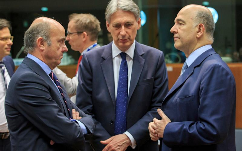 Philip Hammond, centre, in Brussels - Credit: OLIVIER HOSLET/EPA