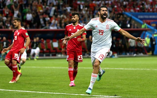 "8:54PM Full time Iran 0 Spain 1 8:54PM 90+3 mins - Iran 0 Spain 1 A long lump fails to find an Iranian player. And again. They are trying, without having anything fall for them. Here comes a long throw, though... Mohammadi will fling the ball into the Spain box. He gives it a kiss, then does a somersault and bails out! What on earth was that?!? His second attempt is to a player nearby instead and the move peters out. 8:51PM 90+2 mins - Iran 0 Spain 1 Ebrahimi is shown yellow for a foul on Rodrigo and that means Spain have a free-kick about 25 yards out on the left flank. Isco takes, but it fails to beat the first Iranian defender. Plenty of time was wasted, though. 8:49PM 90 mins - Iran 0 Spain 1 Spain are keeping possession smartly now, with Iran run-ragged from all of their defensive work earlier in the match. Four minutes of stoppage time to be played. 8:48PM 88 mins - Iran 0 Spain 1 Costa's night is up, to be replaced by the Valencia striker Rodrigo. 8:46PM 87 mins - Iran 0 Spain 1 Back to front, front to back from Spain. That will take up another minute. Almost there. Credit: getty images 8:44PM 85 mins - Iran 0 Spain 1 Spain just need to take the sting out of this now. Or score again. One of those two things, you know. 8:42PM 83 mins - Iran 0 Spain 1 That is an enormous chance for Iran!!!! Amiri nutmegs Pique on the left and delivers a sublime cross to Taremi at the far post. He rises to meet the ball inside the six-yard box and has a whole heap of goal to aim at, but his header flies over the bar. So close. So very close. 8:41PM 81 mins - Iran 0 Spain 1 Sexy stuff from Isco to beat a smattering of Iran players before playing and receiving a one-two to drive into the penalty area where he is put on his backside by a crunching tackle. 8:39PM 79 mins - Iran 0 Spain 1 Amiri is booked for a rash challenge on Carvajal. Then Vazquez heads off to be replaced by Asensio. 8:36PM 77 mins - Iran 0 Spain 1 Spain have a free-kick here in a great position 20 yards from goal and to the right. Surely this is perfect for the left foot of Silva... nope, Isco has a go with his right peg and the wall jump to keep it out. 8:35PM 75 mins - Iran 0 Spain 1 What a ball from the substitute Mohammadi, who crosses wonderfully from the left flank, but it sails about two yards in front of the onrushing Taremi and out for a goal kick. They are certainly giving it some. 8:30PM 71 mins - Iran 0 Spain 1 A couple of changes. Mohammadi is on in place of the injured Safi, while Koke replaces the ageing Iniesta. 8:30PM 70 mins - Iran 0 Spain 1 A touch of magic down the left from Iniesta, whose close control is superb and Spain win a corner. I'm not sure how describe what then happens... The ball is worked low to the near post and then back to Ramos whose shot it blocked on the line. From that moment about half a dozen Iranian players fling themselves on top of the ball and Spain cannot hack it over the line. The ultimate bundle. Brilliant Sunday League football. Heartening stuff. Great to see #IRNESP taking a lead from Chesterfield and Bury.#WorldCup pic.twitter.com/eAkDxMM5Fj— Crap 90s Football (@Crap90sFootball) June 20, 2018 8:26PM 67 mins - Iran 0 Spain 1 It's almost like a normal football match now. You know, when both sides try to score. All sorts of space all over the pitch. 8:24PM 65 mins - Iran 0 Spain 1 Nothing the Iranian players can really argue about there. Replays showed Ezatolahi was definitely offisde. This game is so much more open now. 8:23PM GOAL DISALLOWED!!!! Ezatolahi was inches offside when the cross was swung in! Oh deary me. Wow. 8:22PM VAR review Still we wait to hear if it offside... 8:22PM GOOOOOOOOOOOAAAAAAAAAAAAAAAAAL Iran have a free-kick about 30 yards out on the right here. Can they conjure something? YES THEY CAN!!!!!!!!!!!!!!!!!!!!!!!!!!!!!!!!!!!!!!!!!!!!!!!!!!!!!!!!!!!!!!!!!!!!!!!!!!!!!!!! The cross comes in, there is an almighty scramble and then Ezatolahi bundles into the net. But they are checking VAR for offside... 8:19PM 60 mins - Iran 0 Spain 1 Iran are looking to build attacking moves now, throwing more bodies forward and it is Taremi who rises highest to meet a cross from the right. He cannot get his header on target though and it trickles past the far post. 8:18PM 58 mins - Iran 0 Spain 1 It's immediately apparent that the game is more open since that goal. Iran cannot afford to just sit back as they have been up until now. The result may well be more goals. 8:15PM 56 mins - Iran 0 Spain 1 Well, well, well. What does that mean for Iran's tactics now? Costa scores his 3rd of the tournament. Only a great striker can finish like that. ��— Gary Lineker (@GaryLineker) June 20, 2018 8:14PM GOOOOOOOOOOOAAAAAAAAAAAAAAAAAL Finally Spain find a way through. Iniesta plays in Costa, who attempts to turn inside the Iran penalty area. Rezaeian comes across to make the tackle, but the ball ricochets straight into Costa's shin and then the bottom corner of the net. I'm not sure if Costa knew anything about that. Iran 0 - 1 Spain (Diego Costa, 54 min) 8:13PM 53 mins - Iran 0 Spain 0 Oh my word! Everyone thought Iran had just scored!!!! A long throw is headed to Ansarifard who absolutely drills the ball towards the Spain goal from just inside the penalty area. De Gea is stood helpless and watching as the ball flies inches wide of the near post and into the side-netting. 8:11PM 52 mins - Iran 0 Spain 0 It looks like Spain have sent their wingers a lot wider in this half in an attempt to stretch the game across the pitch. And it looks to be having a bit more success, with greater space to work a move from. This time it comes from the right and the ball is pulled back to Isco, who fires over the bar. 8:09PM 50 mins - Iran 0 Spain 0 Close again for Spain as Pique meets a corner and nods towards goal, but he cannot get enough on it and the man on the line hacks it away. The ball is then worked to Busquets who lets fly from 25 yards. Beiranvand dives to his left and palms it up, before then flapping it away with Vazquez advancing on him. 8:08PM 48 mins - Iran 0 Spain 0 As was entirely predictable, both sides have instantly slotted into their same positions as the first half. Not sure if it's some sort of cry for help, but Spain appear to be passing themselves a picture of Vicente del Bosque's face pic.twitter.com/oyesO5RqQV— Adam Hurrey (@FootballCliches) June 20, 2018 8:06PM 47 mins - Iran 0 Spain 0 The Spanish players were in the referee's ear quite a lot in the tunnel before they came out. I suspect they might have been moaning about the Iranian players' time-wasting and, how to put this neatly, erm... gamesmanship at times. I'll be honest, I didn't see anything wrong with their behaviour in the first half. But maybe that's just me. 8:05PM Kick-off The second half begins. 8:03PM What a man Isco. My man �� pic.twitter.com/uO1UlymeOW— R•Madrid Pics �� (@RM_Pictures) June 20, 2018 8:03PM Half-time stats These are brilliant: Iran vs Spain shots on goal Iran vs Spain Average touch positions (half time) 7:50PM Analysis This is as one-sided a game as you will ever see. It's total attack against defence, but Iran have been superb. If they hold out for 90 minutes it will be a phenomenal defensive performance. Every time a Spanish player has the ball in the final third, there is a man in red snapping at his heels or throwing his body in front of him. And Beiranvand has barely been troubled in goal. Strange. Very strange. But fascinating. 7:48PM Half time Iran 0 Spain 0 - Well, somehow Iran have survived a half and they are treated to a breather. 7:47PM 45+1 mins - Iran 0 Spain 0 Close for Spain as Silva shoots from the edge of the box, but yet another Iran defender flings himself at the ball and deflects it wide for a corner that comes to nothing. 7:45PM 45 mins - Iran 0 Spain 0 Three minutes of stoppage time to be played. 7:44PM 44 mins - Iran 0 Spain 0 Iran are now just thumping the ball upfield and waiting for the next wave of attack. And again. And again. And again. There is zero attempt to retain possession. 7:42PM 42 mins - Iran 0 Spain 0 For all the magicians in the Spanish midfield, they just cannot find a way through. Isco does well to cross low from the left and pick out Iniesta, but the (soon to be) Barcelona man is pounced upon in a flash. I can imagine Spain fans are starting to get very frustrated. 7:40PM 40 mins - Iran 0 Spain 0 What's happened here? Iran's keeper Beiranvard has gone down and reckons there was some sort of stamp from Costa, who - you probably don't need me to say - is vociferously protesting his innocence. Replays show it is a lot of fuss over nothing. Costa's foot possibly connected with Beiranvard's toes as the keeper picked up the ball, but there wasn't anything in it. 7:37PM 37 mins - Iran 0 Spain 0 Now Iran have a corner! Pique was forced to head an incoming cross behind his own goal. Ansarifard will take the corner, but it is headed easily away. 7:35PM 35 mins - Iran 0 Spain 0 Iran have a throw-in deep inside the Spanish half and the crowd have gone berserk! Safi will attempt the long throw into the box, but the chance is cleared in a flash. 7:33PM 33 mins - Iran 0 Spain 0 The Iranians have almost stopped even bothering to try and venture in the Spain half. They are exerting so much energy just keeping the opposition out. Surely this cannot last 90 minutes. They are playing as though this is the 88th minute of a match, not the 33rd. 7:30PM 30 mins - Iran 0 Spain 0 A gorgeous one-two between Iniesta and Isco finally sees Spain work their way into the Iranian penalty area, but Iniesta's shot is brilliantly blocked on its way to goal. That was a touch of magic from Isco to find his team-mate. The corner falls to Silva, but he cannot keep his shot down to test the keeper. 7:28PM 28 mins - Iran 0 Spain 0 These average touch positions tell a story. Only three outfield players in the Spanish half! Average touch positions (25 min) 7:26PM 26 mins - Iran 0 Spain 0 It's total one-way traffic, but it's been quite an engrossing start to this match. A bruising start as well, with tackles flying in all over the place. 7:24PM 24 mins - Iran 0 Spain 0 ... Silva will be the man to take with his left foot. He strikes it well, but straight into the midriff of Beiranvard, via a deflection off the wall. 7:24PM 23 mins - Iran 0 Spain 0 And Spain earn another free-kick marginally closer to goal. I suspect one of Spain's players with greater finesse will take this one, rather than Ramos... 7:22PM 22 mins - Iran 0 Spain 0 ""It's an attack v defence training session,"" says Clive Tyldesley. ""But they know what they are doing,"" adds Glenn Hoddle, of Iran's defence. Spain have earned a free-kick about 25 yards out from goal, though, and Ramos looks as though he fancies it. But his shot fails to beat the wall. 7:20PM 20 mins - Iran 0 Spain 0 The Iran tactic is quite clear: defend, defend, defend, defend, and then hope to snaffle something on the break. And the defending part is working a treat so far. They look so tightly drilled, but can they keep it up for 90 minutes? 7:19PM 19 mins - Iran 0 Spain 0 Just a hint of space opens up for Silva, which allows the Manchester City man to have a crack from outside the penalty area, but it cracks into a red-shirted defender and away to safety. Iran seem to have a line of six men in defence when Spain have the ball. 7:18PM 17 mins - Iran 0 Spain 0 The racket whenever an Iranian player gets on the ball is very impressive. They must have a hell of a lot of fans inside the stadium. And they have something to cheer here as Taremi receives the ball behind the Spanish defence and everyone seems to stop while waiting for an offside flag to be raised. It never comes though, so Taremi hares forward and crosses into the penalty area, but there is no one to get on the end of it. 7:15PM 15 mins - Iran 0 Spain 0 Spain are struggling slightly at the moment to penetrate this Iranian team, which has been set up tightly with men behind the ball. 7:13PM 13 mins - Iran 0 Spain 0 It's pretty niggly out there at the moment. Both sides committing plenty of fouls, before arguing profusely with the referee. All very tiresome. 7:13PM 12 mins - Iran 0 Spain 0 A little bit of breaking news from the England camp (and this is not a joke): Gareth Southgate has dislocated his shoulder while out running!!!!!!! 7:10PM 10 mins - Iran 0 Spain 0 This could be dangerous. Iran concede a free-kick about 10 yards in from the left and 10 yards from the penalty area. Isco will be the man to whip it in... no he won't, the left-footed Alba crosses instead, the ball flicks off Pique's head and out for a throw on the other side of the pitch. 7:08PM 8 mins - Iran 0 Spain 0 The first (of what will presumably be many) talking to of the evening for Ramos after a foul near the middle of the pitch. Not sure there was anything in it as the two men went up for a header together. 7:06PM 6 mins - Iran 0 Spain 0 Oh what have we here? Here come the Iranians as Azmoun gets in behind the Spain defence and finds Amiri, who darts to the byline and is bundled over to win a free-kick by the corner flag. Can they produce something from this? No. The cross is headed clear by Pique. 7:04PM 4 mins - Iran 0 Spain 0 Early impressions: Spain are going to see a lot of the ball during this match. Iran are going to sit back and be as physical as possible. Beiranvand is called into action for the first time to punch a loopy cross into the night before Carvajal slashes a long-range shot a long way high and wide. 7:02PM 2 mins - Iran 0 Spain 0 Huge noise from the Iranian contingent inside the stadium. Quite a din in Kazan. 7:00PM Kick off Spain, in white, get this match underway. Iran in red. let's go. 6:53PM Ready for action The players are out and it's national anthem time. 6:45PM Always prepared Bit excessive. Then again, if it rains and he hadn't laminated them, we'd be ripping into him pic.twitter.com/yCB7vFngP0— Adam Hurrey (@FootballCliches) June 20, 2018 6:40PM Here's the scene in Kazan Credit: getty images Credit: reuters 6:31PM My mate Messi Some more pre-reading for you comes in the form of the latest column from our new Telegraph Sport columnist Cesc Fabregas. This one is entitled: Lionel Messi and me - my 18-year friendship with the world's greatest player Here's an extract: People want to put Leo up against Cristiano and of course they both need each other to make themselves better, but we are talking about different teams, different groups, different moments. I think they just respect each other and get on with it. It's been going on too long for either of them to get annoyed by it. When I went to Arsenal, we lost a little bit of contact, but when I re-signed for Barcelona the friendship grew very quickly again and we had a great connection on the pitch, especially in my first season back. In the first seven games, he had nine goals and I had five, and we were both making assists for each other. It was incredible. Credit: afp 6:20PM Ins and outs So, two changes from the Spain side who drew with Portugal. Nacho is dropped after his wonder-goal and replaced by Dani Carvajal, while Lucas Vazquez comes in for Koke. Iran have tinkered slightly more with Majid Hosseini, Saeid Ezatolahi and Mehdi Taremi all brought into the side. 6:05PM The teams are in TEAM NEWS! We have the Starting XIs for #IRN and #ESP#IRNESPpic.twitter.com/pZQvmZ0B3V— FIFA World Cup �� (@FIFAWorldCup) June 20, 2018 5:54PM Qualifiers Some news from Group A is that it's all been decided just two games in. Uruguay have just beaten Saudi Arabia 1-0, which means both Russia and Uruguay are through to the last-16. Those two sides face each other next Monday to see who tops the group. 5:48PM Open to all While we await the team news, I recommend reading this piece by our man Jim White on the ground in Kazan: How the World Cup is exposing Iranian restrictions on women: 'I was sent to jail for trying to go to a game in Tehran' Here's an extract: For Kiana and Paria, two twenty-something women from Iran, this World Cup has been a liberating experience. For a start, the two of them have been able to do something they never have been able to do in their own country: go to a football match. In fact, earlier this year, when Paria tried to attend a game in her home city she was arrested. The charge was offending public decency. ""I love sport, I love football and in Iran women can't go to watch,"" she explains. ""One night I try. I go to the game and I went to jail."" It happened in March. A rumour was circulating that the Iranian government had relaxed the strict rules preventing women from showing their enthusiasm for the sport. ""We had heard it was OK,"" says Paria. ""We thought they were allowing us."" So she and her boyfriend headed off to see the Tehran derby between Persepolis and Esteghlal. But it was not OK, things had not changed. Along with 29 other women who had mistakenly smelled a whiff of liberalisation in the wind, the moment she tried to go through the turnstiles, Paria was arrested and taken to the police station. Her crime? Being a woman in an all-male environment. The World Cup has given Iran fans Paria (right) and Kiana the opportunity to attend their first football match without the risk of arrest 5:30PM Favourites vs Table Toppers No one would have predicted that in a group featuring Spain, Portugal and Morocco, it would be Iran who ended the first round of games top of the table. But that is exactly where Carlos Queiroz's side found themselves when they woke up this morning. In many senses their 1-0 victory over Morocco was somewhat fortunate, gifted to them courtesy of a 95th-minute Aziz Bouhaddouz own-goal. But such a simple reading of that triumph is to do Iran a disservice. Yes, Morocco dominated possession, but Iran's defence held tight throughout, offering the opposition few clear-cut chances. As for Iran's attacking threat at the other end of the pitch... well, yes, there wasn't much to say about that. And, in all honesty, there shouldn't be much tonight either. For all their table-topping exploits, Iran are facing a significant step up here against a Spanish side who impressed many people despite only drawing their opening encounter with Portugal. After the crazy build-up that saw them sack their head coach barely 48 hours before kick-off, the Spaniards showed plenty of class and would have won with relative ease were it not for the individual brilliance of Cristiano Ronaldo (and a couple of glaring errors). With Germany losing, Brazil and Argentina drawing, and France looking highly unconvincing in victory over Australia, Spain's draw only seemed to strengthen their hopes of winning this tournament. At their best, no other nation in the world can come close to the beauty of their football and, providing they are over any opening match jitters, this Iranian side are not expected to trouble them much. Indeed, you can get 20/1 on Queiroz's lads emerging victorious tonight. Whether the reality is so straightforward will be known in a few hours. I have predicted a 2-0 win to Spain, although I am firmly entrenched near the bottom of our Team Telegraph World Cup prediction competition so I am not a man to be trusted. For what it's worth: Iran are guaranteed a place in the last-16 if they win tonight."