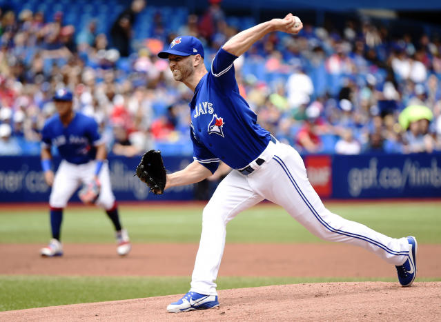 Toronto Blue Jays starting pitcher J.A. Happ works against the Atlanta Braves during the first inning of a baseball game in Toronto, Wednesday, June 20, 2018. (Nathan Denette/The Canadian Press via AP)