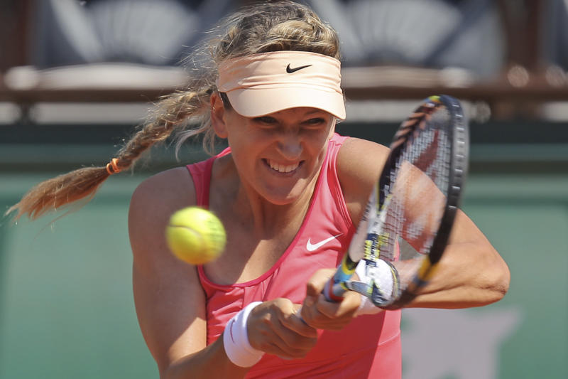 Victoria Azarenka of Belarus returns in her first round match against Alberta Brianti of Italy at the French Open tennis tournament in Roland Garros stadium in Paris, Monday May 28, 2012. (AP Photo/David Vincent)
