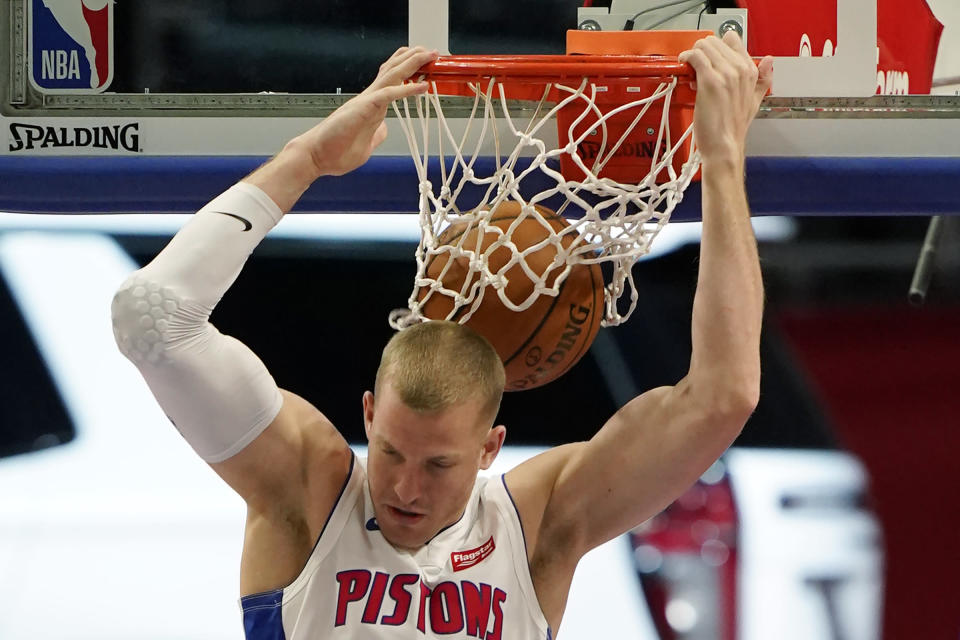 Detroit Pistons center Mason Plumlee dunks during the first half of an NBA basketball game against the Portland Trail Blazers, Wednesday, March 31, 2021, in Detroit. (AP Photo/Carlos Osorio)