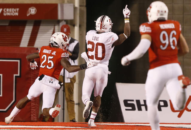 "Stanford running back <a class=""link rapid-noclick-resp"" href=""/ncaaf/players/257525/"" data-ylk=""slk:Bryce Love"">Bryce Love</a> (20) scores a touchdown as Utah defensive back Casey Hughes (25) looks on in the second half during an NCAA college football game Saturday, Oct. 7, 2017, in Salt Lake City. (AP Photo/Rick Bowmer)"