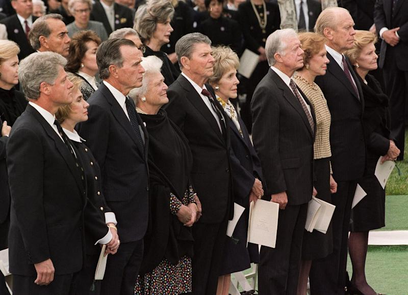 This April 27, 1994 photo shows President Bill Clinton, left, and First Lady Hillary Clinton, being joined by four former presidents and their wives during former president Richard Nixon's funeral in Yorba Linda, Calif.