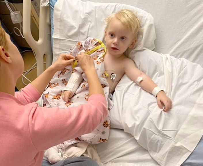 "Elizabeth Timme aids with IV changing. The family routinely changed Bob's IV because kids ""blow out"" their IVs when they are that little and they need to replace them every 12-24 hours. (Photo: Elizabeth Timme)"