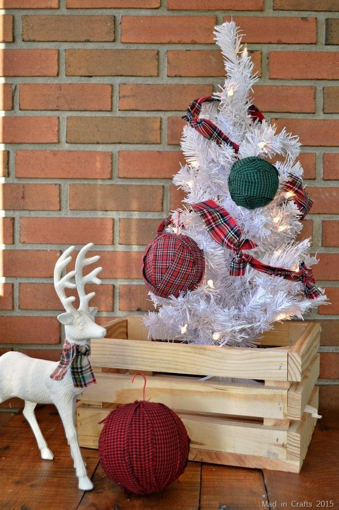 "<p>Dress your Christmas tree in all plaid accents. DIY plaid ornaments and plaid garland will make any tree–whether it's real, fake, green, or white–super cozy.</p><p>Get the tutorial at <a href=""https://madincrafts.com/15-minute-plaid-rag-ornaments/"" rel=""nofollow noopener"" target=""_blank"" data-ylk=""slk:Mad in Crafts"" class=""link rapid-noclick-resp"">Mad in Crafts</a>.</p><p><a class=""link rapid-noclick-resp"" href=""https://www.amazon.com/URATOT-Burlap-Christmas-Wrapping-Decoration/dp/B07VSR746T/ref=sr_1_2?dchild=1&keywords=red+plaid+ribbon&qid=1597241346&sr=8-2&tag=syn-yahoo-20&ascsubtag=%5Bartid%7C10057.g.505%5Bsrc%7Cyahoo-us"" rel=""nofollow noopener"" target=""_blank"" data-ylk=""slk:SHOP RIBBON"">SHOP RIBBON</a><strong><em> Red Plaid Ribbon, $11</em></strong></p>"