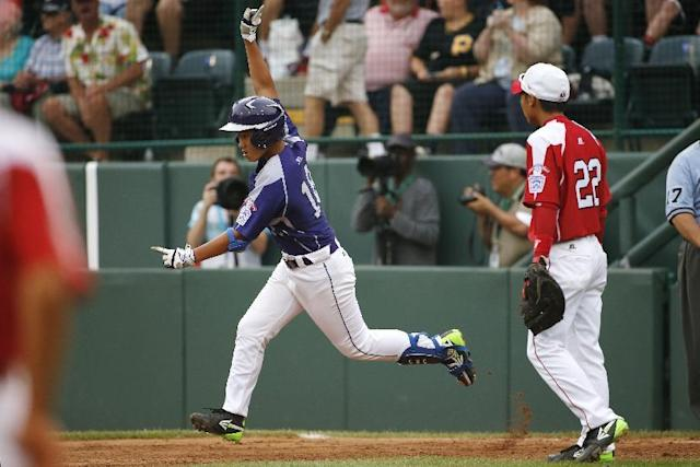 CORRECTS DATE AND YEAR TO AUG. 20, 2014 - Seoul's Jae Yeong Hwang (18) rounds first past Tokyo first baseman Ren Takeuchi (22) after hitting a solo home run off Tokyo pitcher Suguru Kanamori in the sixth inning of a International semi-final baseball game against Tokyo at the Little League World Series tournament in South Williamsport, Pa., Wednesday, Aug. 20, 2014. Seoul won 4-2. (AP Photo/Gene J. Puskar)