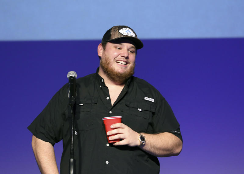 """Luke Combs speaks at """"Luke Combs Joins the Grand Ole Opry Family,"""" at Grand Ole Opry, Tuesday, July 16, 2019, in Nashville, Tenn. (Photo by Al Wagner/Invision/AP)"""