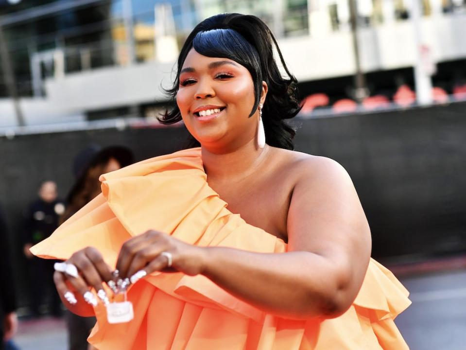 According to Lizzo, the white Valentino micro-bag is one of three in the world.