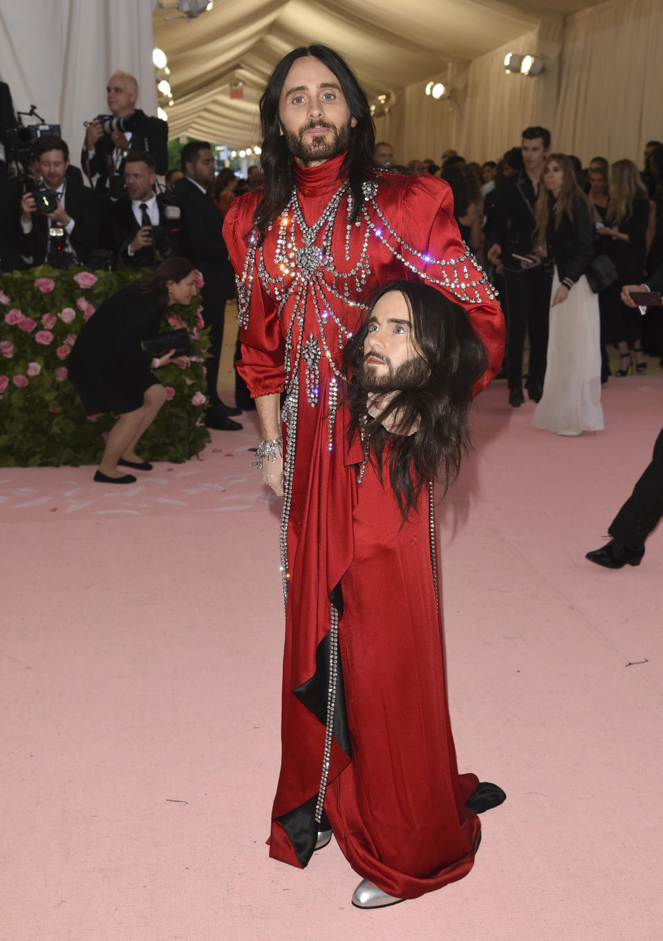 Oscar winner Jared Leto, holding a model of his own head, attended the Met Gala in a cascading red gown matched with a pair of silver heels. Photo: Getty Images