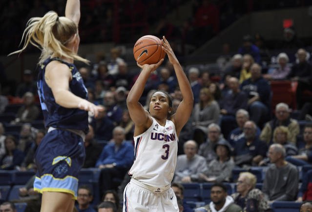 Connecticut's Megan Walker, right, shoots over Jefferson's Allie Warren during the first half of an NCAA college exhibition basketball game, Sunday, Nov. 3, 2019, in Storrs, Conn. (AP Photo/Jessica Hill)