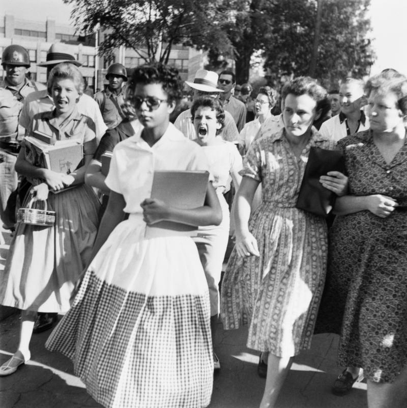 Elizabeth Eckford, one of the group of nine black students known as Little Rock Nine, walks to Little Rock's Central High with an angry mob surrounding her. (Bettmann via Getty Images)