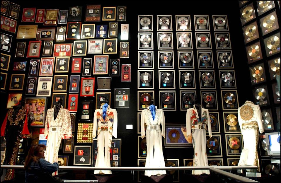 "<p>In 2004, Lisa Marie Presley sold Elvis Presley Enterprise to concert promoter Robert Sillerman for $100 million. The <a href=""https://www.theguardian.com/world/2004/dec/17/usa.arts"" rel=""nofollow noopener"" target=""_blank"" data-ylk=""slk:terms of the deal"" class=""link rapid-noclick-resp"">terms of the deal</a> saw Lisa Marie maintaining ownership of the Graceland estate, her father's ""personal effects,"" and a 15% stake in the company. However, her father's image, name, and likeness are no longer under her control. </p>"