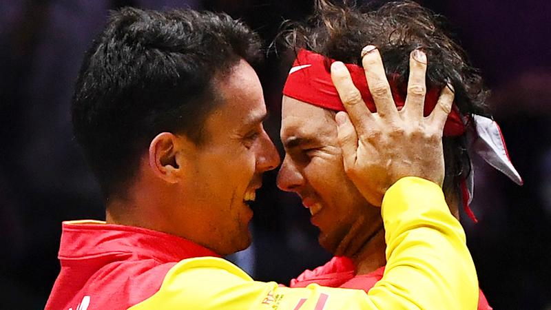 Spain's Roberto Bautista Agut and Rafael Nadal embrace after winning the 2019 Davis Cup. (Photo by GABRIEL BOUYS/AFP via Getty Images)