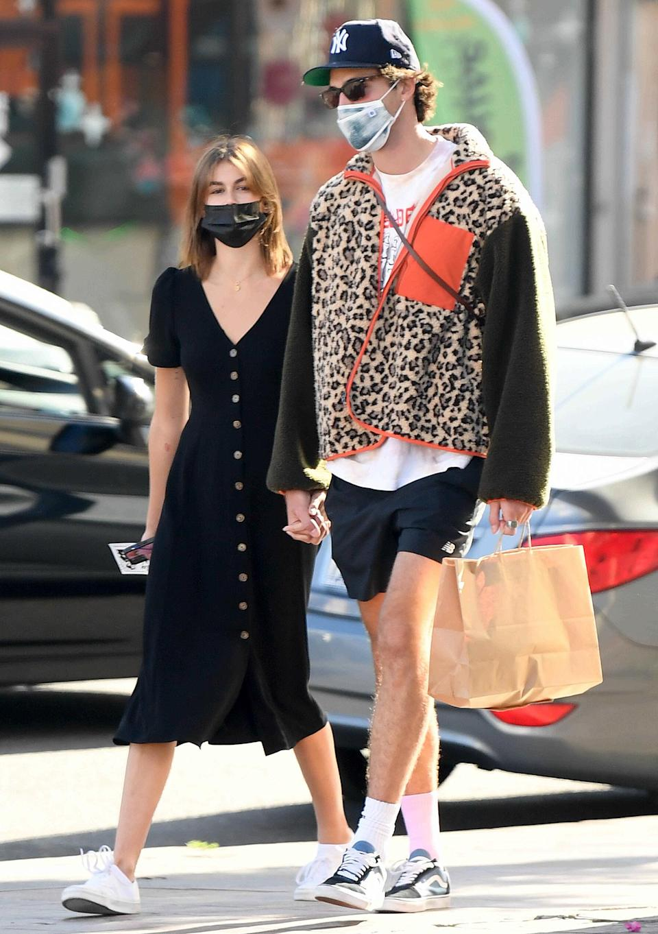 <p>Kaia Gerber and boyfriend Jacob Elordi hold hands on a grocery run on Sunday in L.A. </p>