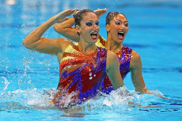 LONDON, ENGLAND - AUGUST 05:  Evangelia Platanioti and Despoina Solomou of Greece compete in the Women's Duets Synchronised Swimming Technical Routine on Day 9 of the London 2012 Olympic Games at the Aquatics Centre  on August 5, 2012 in London, England.  (Photo by Clive Rose/Getty Images)