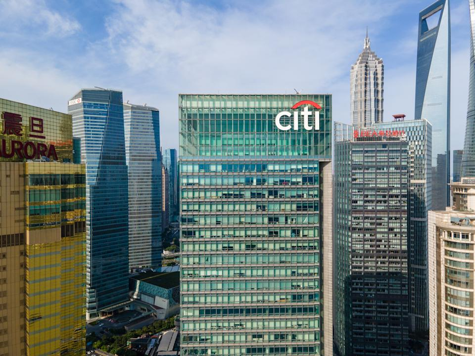 Shanghai, China - Aug 2, 2020: Aerial view of Citibank building in downtown Lujiazui Financial District. With landmark skyscrapers around. Citibank was founded in 1812 as the City Bank New York