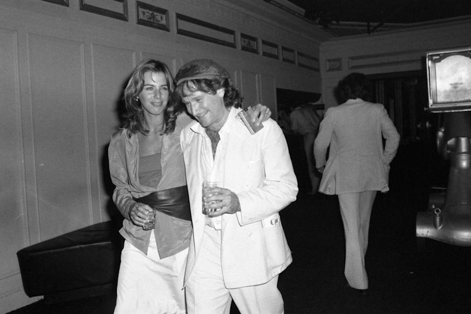 <p>Robin Williams gives in to the disco beat at Studio 54 with model Cheryl Tiegs in 1979.</p>