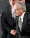 FILE PHOTO: Accused swindler Bernard Madoff enters the Manhattan federal court house in New York