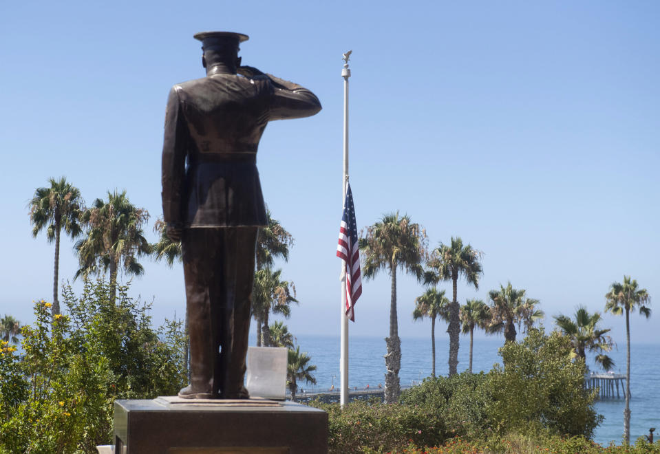 The U.S. flag was lowered to half-staff at Park Semper Fi in San Clemente, Calif., on Friday, July 31, 2020. Officials say a military seafaring assault vehicle with 15 Marines and a Navy sailor aboard sank off the coast of Southern California, leaving one of the Marines dead and eight missing. A Marine Corps spokesman says they were traveling in the amphibious assault vehicle from the shores of San Clemente Island to a Navy ship Thursday evening when they reported that the vehicle was taking on water. (Paul Bersebach/The Orange County Register via AP)