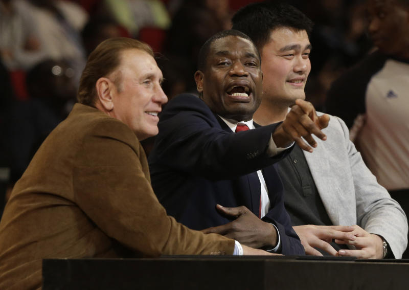 FILE - In this Feb. 16, 2013, file photo, former Houston Rockets coach Rudy Tomjanovich, left, and players Dikembe Mutombo and Yao Ming, right, confer as they judge the slam dunk contest during NBA All-Star Saturday Night in Houston. The votes are in, and word is about to come if this finally is the year that Tomjanovich gets the call from the Basketball Hall of Fame. He's got support from many within the NBA, and his resume has far more than two NBA titles won as coach of the Rockets. The Hall will announce this year's enshrinement class on Saturday. (AP Photo/Pat Sullivan, File)