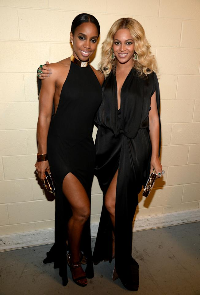 <p>We don't think Bey and Kelly intended on harkening back to their Destiny's Child days with their outfits last night, but we couldn't help but see images of the early aughts in our heads, when the singers would wear complementing outfits to just about everything while they were part of the legendary girl group. For last night's Cotto v. Canelo fight, Beyoncé rocked a piece from Michael Costello's Nirvana Collection, accessorizing with jeweled earrings, a metallic clutch and some really big rings. Kelly donned a high-neck black gown with a thigh high slit, a gold choker with a blinged-out panel, sparkly earrings and strappy sandals.  <i>Photo: Getty</i></p>