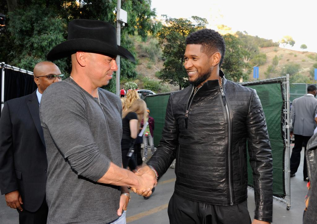 """Performers Kenny Chesney and Usher backstage at the """"A Decade of Difference"""" concert on October 15, 2011, at the Hollywood Bowl, Los Angeles. <br><br>(Photo by Kevin Mazur/Getty Images for Control Room)"""