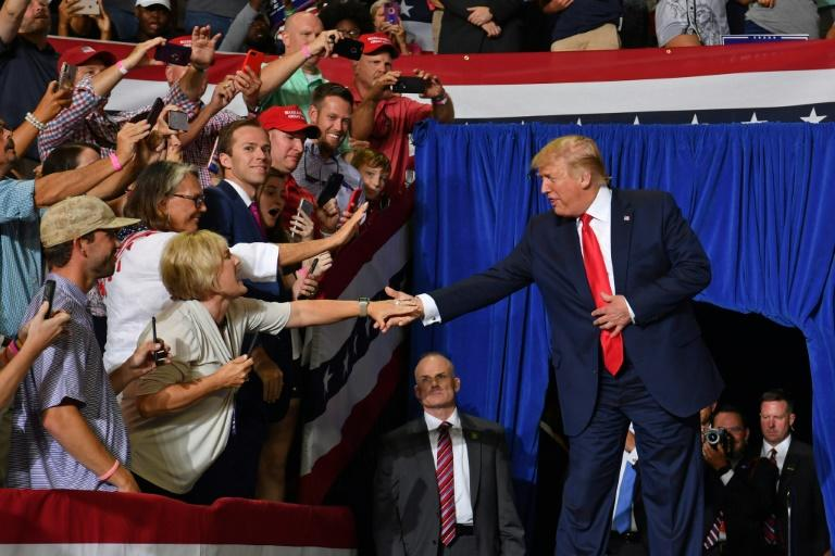 "US President Donald Trump singled out Ilhan Omar for attack at a rally in North Carolina, saying she has ""slandered"" US servicemembers and ""minimized"" 9/11 (AFP Photo/Nicholas Kamm)"
