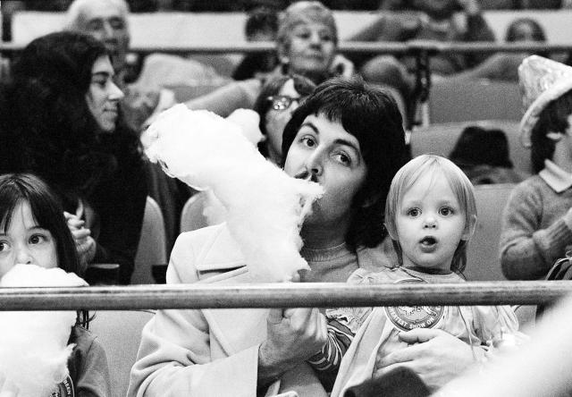 <p>Former Beatle Paul McCartney samples his young daughter Stella's cotton candy as the two sit on the sidelines at New York's Madison Square Garden, March 30, 1974, watching the Ringling Bros. & Barnum and Bailey Circus. (AP Photo/Suzanne Vlamis) </p>