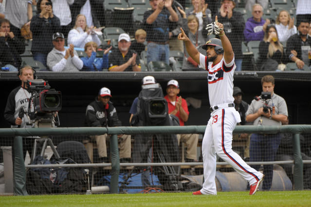 Chicago White Sox's Jose Abreu (79) waves to fans as he leaves the baseball game against the Detroit Tigers during the sixth inning Sunday, Sept. 29, 2019, in Chicago. (AP Photo/Mark Black)