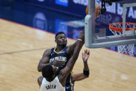 New Orleans Pelicans forward Zion Williamson shoots over Brooklyn Nets forward Jeff Green in the second half of an NBA basketball game in New Orleans, Tuesday, April 20, 2021. (AP Photo/Gerald Herbert)