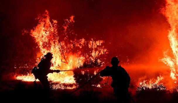 PHOTO: The Bobcat Fire burns in Juniper Hills, Calif., Sept. 19, 2020, as firefighters work to put out the flames. (Frederic J. Brown/AFP via Getty Images)