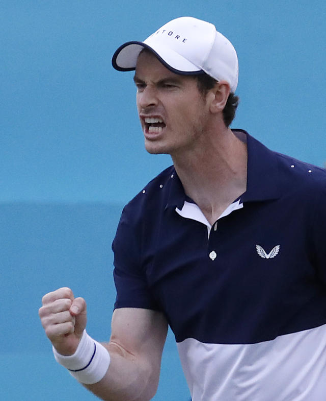 Andy Murray of Britain celebrates a point as he plays with Feliciano Lopez of Spain during their doubles match against Juan Sebastian Cabal and Robert Farah of Colombia at the Queens Club tennis tournament in London, Thursday, June 20, 2019.(AP Photo/Frank Augstein)