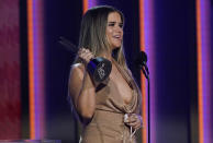 Maren Morris accepts the award for female artist of the year at the 56th annual Academy of Country Music Awards on Sunday, April 18, 2021, at the Grand Ole Opry in Nashville, Tenn. (AP Photo/Mark Humphrey)