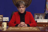 """This computer screen capture from Kansas Gov. Laura Kelly's page on Facebook shows her giving the annual State of the State address, Tuesday, Kan., Tuesday, Jan. 12, 2021, in Topeka, Kan. Kelly says that given the recent mob violence in Washington, the state's leaders must """"must commit ourselves to set an example"""" of working together. (AP Photo/John Hanna)"""