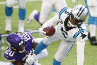 Carolina Panthers quarterback Teddy Bridgewater (5) tries to break a tackle by Minnesota Vikings cornerback Jeff Gladney (20) during the second half of an NFL football game, Sunday, Nov. 29, 2020, in Minneapolis. (AP Photo/Bruce Kluckhohn)