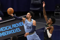 Memphis Grizzlies' Dillon Brooks (24) shoots past Minnesota Timberwolves' Jaden McDaniels (3) during the first half of an NBA basketball game Wednesday, May 5, 2021, in Minneapolis. (AP Photo/Jim Mone)