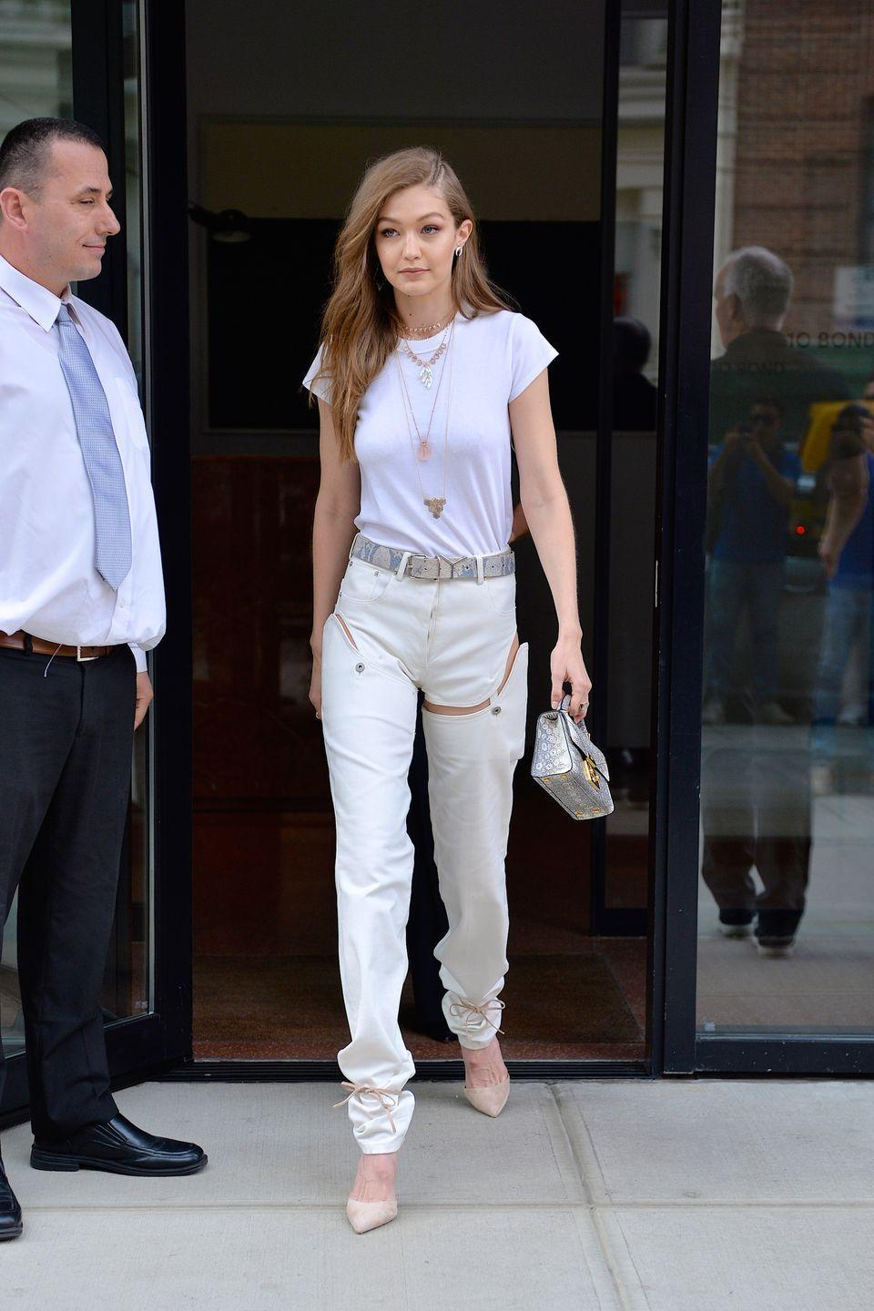 <p>As a professional outfit-wearer, Gigi can pull off <em>anything </em>– including the 2017 version of those zip-off-at-the-knee pants from your childhood. Her all-white ensemble was anything but boring with these negative space booty short-jeans. </p>
