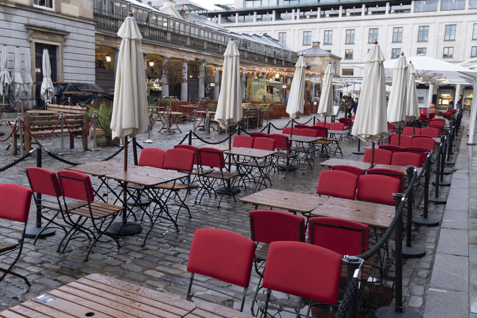 Empty seating awaits bar and restaurant customers on a wet and rainy day in Covent Garden during the second wave of the Coronavirus pandemic and when the capital is designated by the government as a Tier 2 restriction, on 21st October 2020, in London, England. (Photo by Richard Baker / In Pictures via Getty Images)
