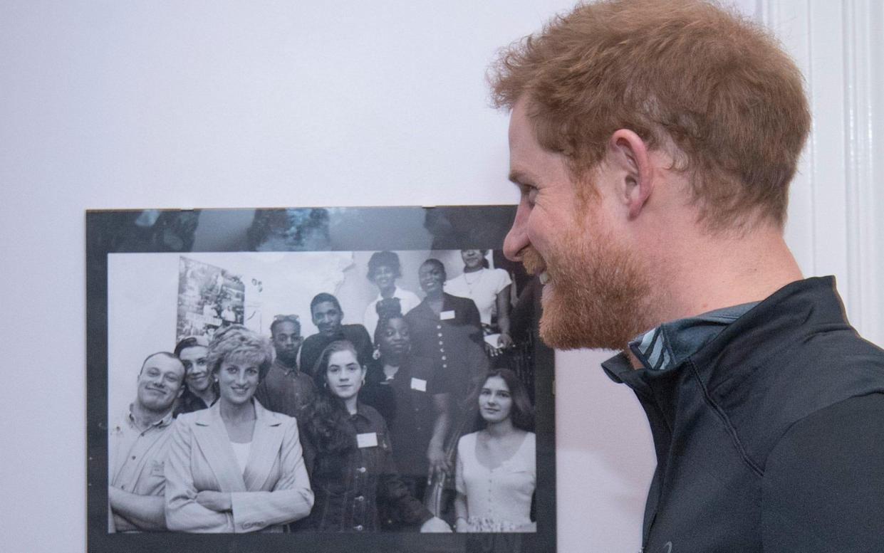 <span>Prince Harry with a picture of his mother Princess Diana, with staff and users of The Running Charity, which is the UK's first running-orientated programme for homeless and vulnerable young people, in Willesden in north west London.</span> <span>Credit: Geoff Pugh </span>